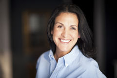 Mature Spanish Businesswoman Smiling At The Camera. At The Office. CEO Royalty Free Stock Images
