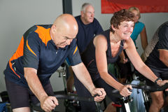 Mature spinning class Stock Photo