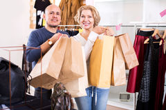 Mature spouses carrying bags with purchases Royalty Free Stock Image