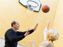 Mature spouses throwing the ball Stock Photo