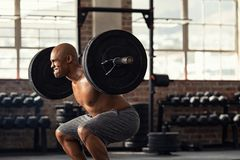 Mature strong man lifting weights at crossfit royalty free stock photography
