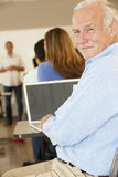 Mature student in class Royalty Free Stock Image