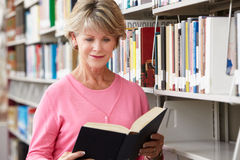 Mature student in library Royalty Free Stock Image