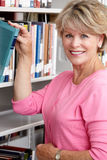 Mature student in library Royalty Free Stock Photo