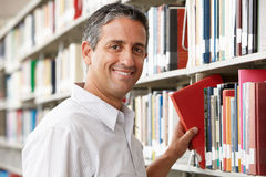 Mature student in library Royalty Free Stock Photography