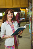 Mature student in the library Royalty Free Stock Photography