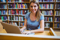 Mature student in the library using laptop Royalty Free Stock Photos