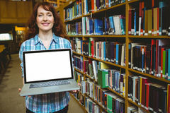 Mature student in library using laptop Stock Photos