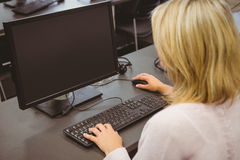 Mature student looking at computer screen Stock Photo