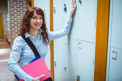 Mature student opening her locker Royalty Free Stock Image