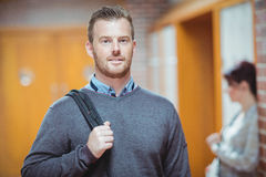 Mature student standing in the corridor Royalty Free Stock Photo