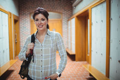 Mature student standing in the locker room Royalty Free Stock Images