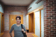 Mature student standing in the locker room Royalty Free Stock Photo