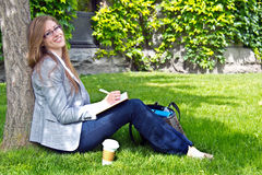 Mature student studies outside on campus Stock Photography