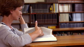 Mature student studying in the library stock footage
