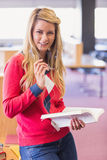 Mature student studying in the library Stock Photography