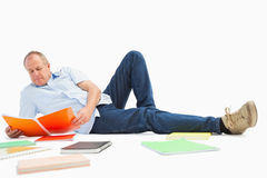 Mature student studying from notebook Stock Images