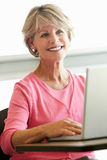 Mature student using computer in class Royalty Free Stock Image