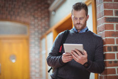 Mature student using digital tablet. At the college Royalty Free Stock Photo