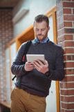 Mature student using digital tablet. At the college Royalty Free Stock Images