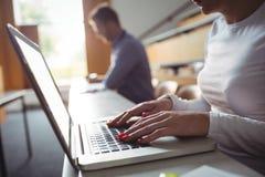 Mature student using laptop Stock Image