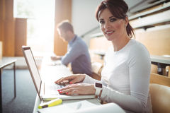 Mature student using laptop Stock Photography