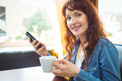 Mature student using phone in cafe Royalty Free Stock Photography
