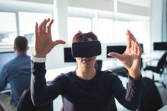 Mature student using virtual reality headset. To help with studying at college Stock Photo