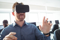 Mature student using virtual reality headset. To help with studying at college Stock Photos