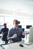 Mature student using virtual reality headset. To help with studying at college Royalty Free Stock Image