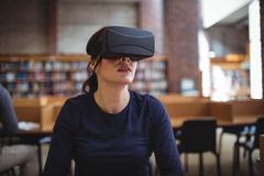 Mature student using virtual reality headset. To help with studying in college library Royalty Free Stock Images
