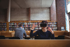 Mature student using virtual reality headset. To help with studying in college library Stock Photography