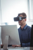 Mature student in virtual reality headset using computer. To help with studying at college Royalty Free Stock Photo