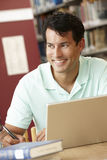 Mature student working in library Royalty Free Stock Photos