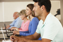Mature students in class stock images
