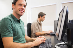 Mature students in computer room Stock Photo