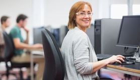 Mature students in the computer room Royalty Free Stock Photography