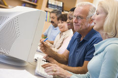 Mature students learning computer skills stock image