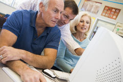 Mature students learning computer skills Royalty Free Stock Photo