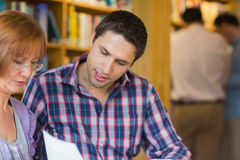 Mature students in the library Royalty Free Stock Photos
