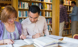 Mature students in the library Stock Image