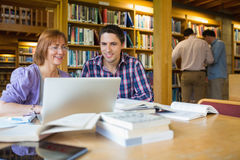 Mature students in the library Stock Photos