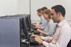 Mature students sitting in computer class Stock Photography