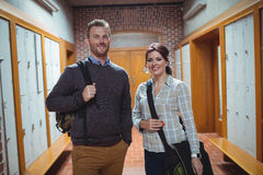 Mature students standing in the corridor Royalty Free Stock Photo
