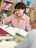 Mature students studying in library Royalty Free Stock Image