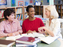 Mature students studying in library Royalty Free Stock Images