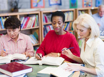 Mature students studying in library Stock Images