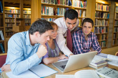 Mature students with teacher and laptop in library Stock Photos