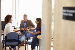 Mature Students Working In College Breakout Area Royalty Free Stock Image