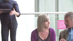 Mature Students Working In College Breakout Area stock video footage